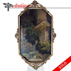 Framed lithograph print of Saint Bernard dog and cottage scene with convex glass and hammered frame