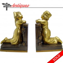 Ronson Grecian bookends with Dutch boy and girl kneeling at a fence, 1920's