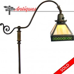 Handel electric floor lamp with bronze base and green slag glass shade in Arts & Crafts style