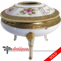 Hand-painted Nippon porcelain hair receiver with raised gold and floral pattern