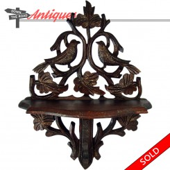 Hand-carved Victorian black forest walnut curio shelf with birds and gold fleck finish