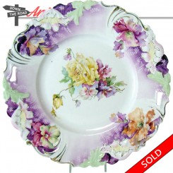 Hand-painted German porcelain plate with floral design and cut-out handles, marked Saxe