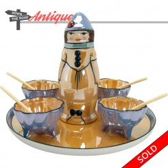 Noritake Lusterware porcelain condiment set with figural female shaker and four salts