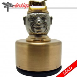 Evans music box lighter with removable insert and man's spinning head