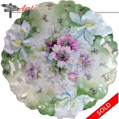 R. S. Prussia porcelain plate with hand-painted floral design and two cut-out handles
