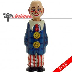 Creepy clown wind-up toy with blinking eyes, made in Germany