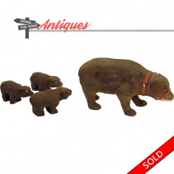 Set of four composition bear and cub figurines with glass eyes