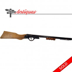 Spring-loaded toy cork rifle with wood stock, circa 1940