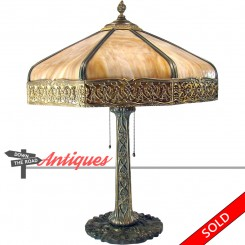 Large eight-paneled art glass electric table lamp with acorn pulls