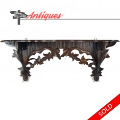 Black walnut wood shelf with hand-carved leaves, circa 1880's