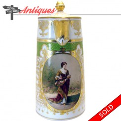 Hand-painted German porcelain teapot with portrait of a woman holding flowers