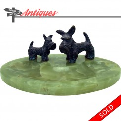 Green marble dresser tray with two bronze Scottish terriers