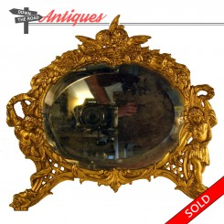 Antique oval dresser mirror with figural angels and Man of the North feet