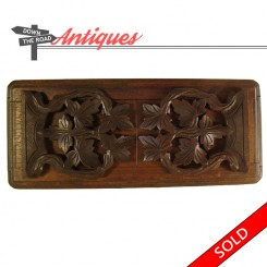 Carved Black Forest walnut expandable book holder with hinged sliding flaps, 1900's