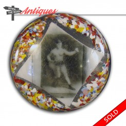 Antique glass paperweight with boxer and confetti design