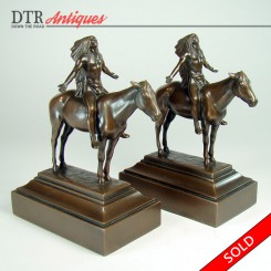 Pair of bronzed Native Americans on horses bookends with brown patina