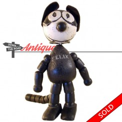 Schoenhut Felix the Cat toy, jointed wood doll with leather ears