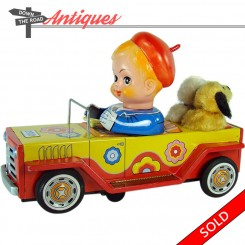 Battery-operated boy with dogs driving red  car with lights and barking sound