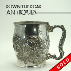 Silver Plated Repoussé Baby's Cup with Blown-out Head and Floral Design - 1890's (SOLD)