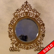 Reticulated Brass Dresser Mirror with Lion Heads and Beveled Glass (SOLD)