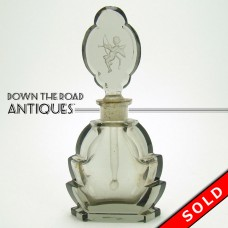 Czechoslovakian Cut Glass Topaz Perfume Bottle with Cupid (SOLD)